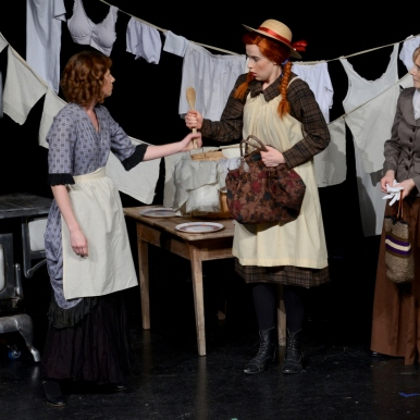 Mrs. Blewett's laundry line...(Kendra Friesen (Mrs. Blewett), Kira Fondse (Anne), and Emmy Friesen (Mrs. Spencer)